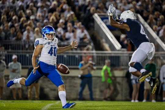 Journey Brown of the Penn State Nittany Lions partially blocks a punt by Evan Finegan of the Buffalo Bulls during the second half at Beaver Stadium on September 07, 2019 in State College, Pennsylvania. Finegan suffered a leg injury on the play and was carted off the field.