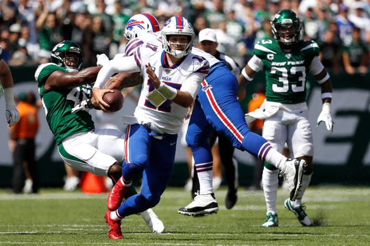 Buffalo Bills quarterback Josh Allen scrambles against the New York Jets during the first quarter at MetLife Stadium last Sunday.
