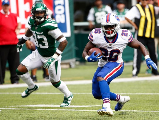 Devin Singletary of the Buffalo Bills dodges Jamal Adams  of the New York Jets during a game at MetLife Stadium on September 8, 2019 in East Rutherford, New Jersey.