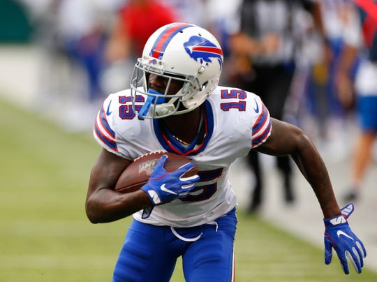 Buffalo Bills wide receiver John Brown (15) runs for a touchdown after a catch against New York Jets cornerback Darryl Roberts (27) during the second half at MetLife Stadium.