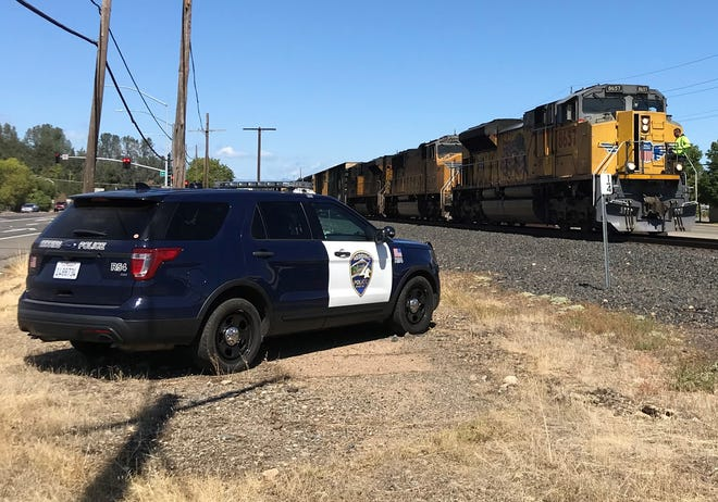 A man was struck and killed as he walked along the railroad tracks in downtown Redding on Sunday.