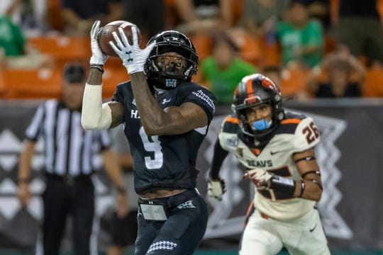 Hawaii wide receiver JoJo Ward (9) catches a pass for a touchdown while being defended by Oregon State defensive back Jojo Forest (26) during the second half of an NCAA college football game, Sept. 7, 2019, in Honolulu.