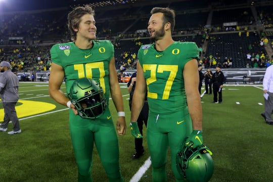 Sep 7, 2019; Eugene, OR, USA; Oregon Ducks quarterback Justin Herbert (10) and tight end Jacob Breeland (27) are all smiles after a 77-6 win over Nevada Wolf Pack at Autzen Stadium. Mandatory Credit: Jaime Valdez-USA TODAY Sports
