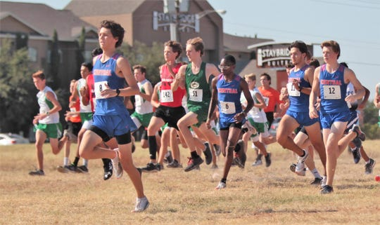 San Angelo Central's C.J. Banks (6) runs at the start of the ASU Stampede Cross Country meet boys division race Saturday, Sept. 7, 2019, at Angelo State University.