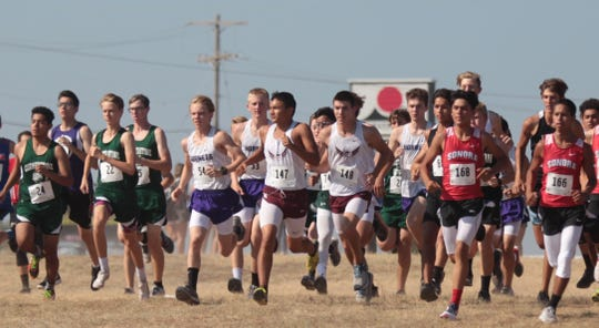 Runners from Cornerstone Christian, Irion County, Rankin and Sonora compete at the start of the ASU Stampede Cross Country meet boys division race Saturday, Sept. 7, 2019, at Angelo State University.
