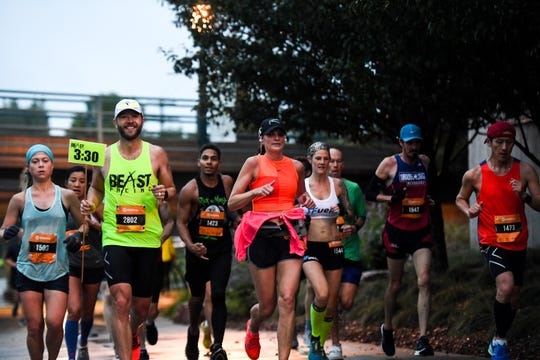 Runners make their way along the river during the Sioux Falls Marathon on Sunday, Sept. 8, 2019.