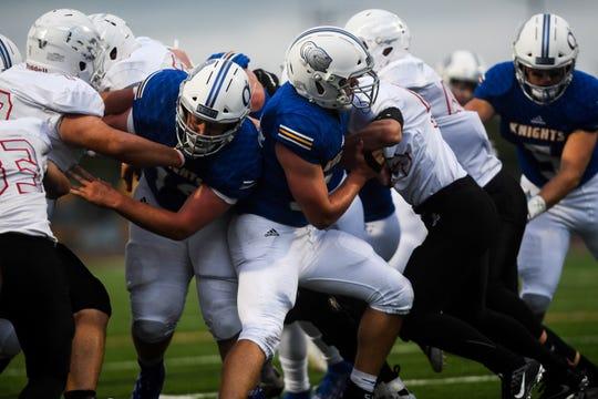 Brandon Valley defense blocks O'Gorman offense during the Bob Burns Dakota Bowl at Howard Wood Field on Saturday, Sept. 7, 2019.