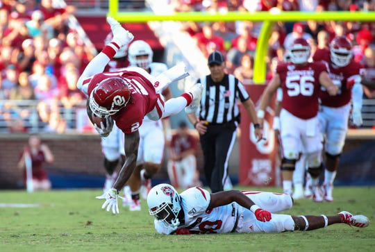 Oklahoma Sooners wide receiver CeeDee Lamb (2) leaps over South Dakota Coyotes defensive back Cori Fant Jr. (20) during the first quarter at Gaylord Family - Oklahoma Memorial Stadium. Mandatory Credit: Kevin Jairaj-USA TODAY Sports
