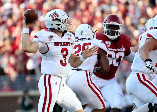 South Dakota Coyotes quarterback Austin Simmons (3) throws during the first half against the Oklahoma Sooners at Gaylord Family - Oklahoma Memorial Stadium. Mandatory Credit: Kevin Jairaj-USA TODAY Sports