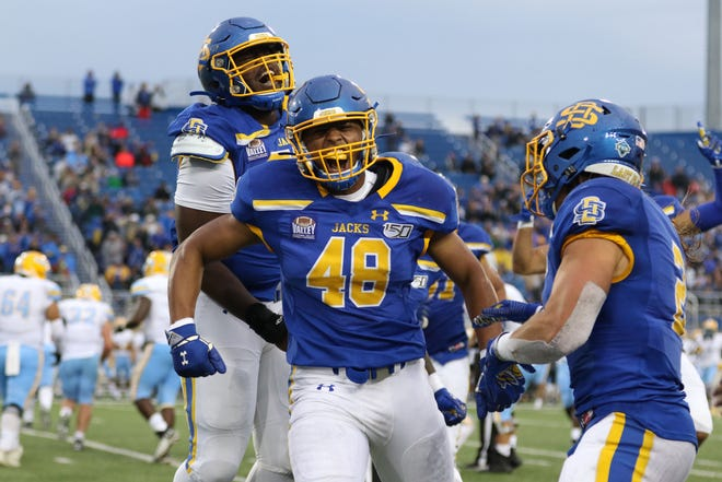 South Dakota State's Quinton Hicks (48) celebrates with teammates after recovering a fumble during the second quarter of the Jackrabbits' matchup against the Sharks Saturday evening in Brookings. Jason Salzman/For The Argus Leader