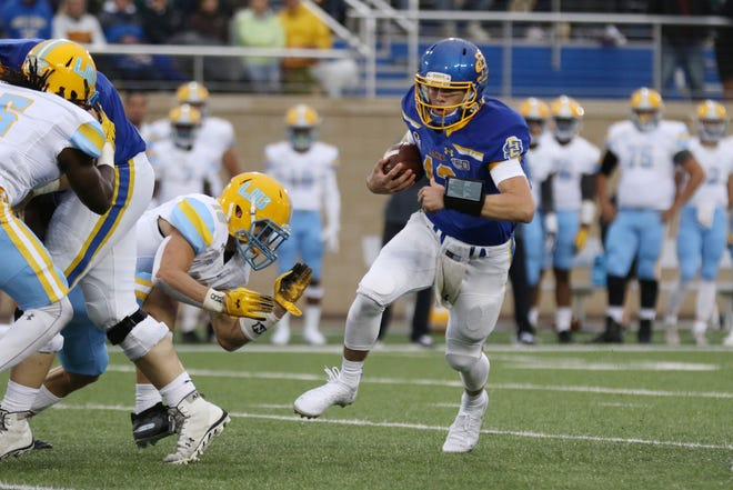 South Dakota State's Keaton Heide (13) sprints sprints through a hole during the second quarter of the Jackrabbits' matchup against the Sharks Saturday afternoon in Brookings. Jason Salzman/For the Argus Leader