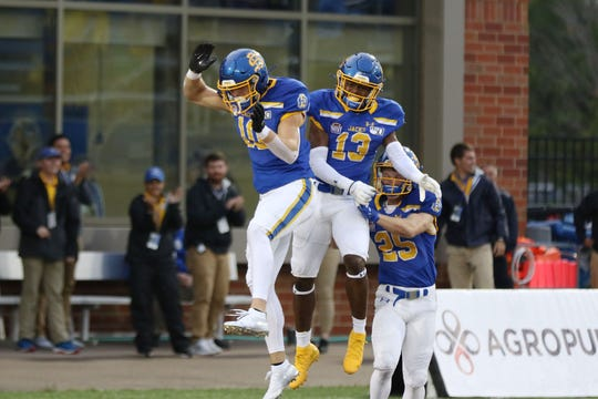 South Dakota State's Jaxon Janke (10) celebrates with DyShawn Gales after returning a punt for a touchdown during the second quarter of the Jackrabbits' matchup against the Sharks Saturday afternoon in Brookings. Jason Salzman/For the Argus Leader