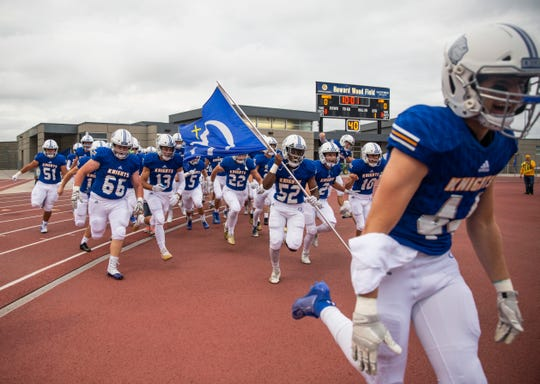 O'Gorman football players run onto the field during the Bob Burns Dakota Bowl at Howard Wood Field on Saturday, Sept. 7, 2019.