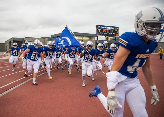 O'Gorman football players run onto the field during the Bob Burns Dakota Bowl at Howard Wood Field on Saturday, Sept. 7, 2019.