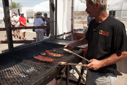 A rack of ribs from Texas Outlaws BBQ is prepared before being served at the 2019 CasaBlanca Rib Fest on Saturday, Sept. 7, 2019.