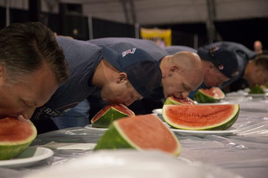 Mesquite police and firefighters compete in the watermelon eating contest at the Casablanca during the annual Rib Fest Saturday, Sept. 7, 2019.