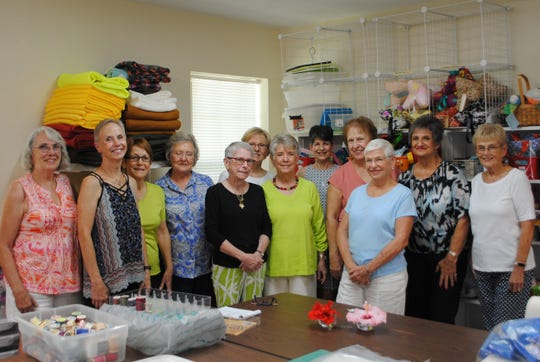 A Bag For Hope volunteers use donated materials to sew bags and other items to sell to raise money for Hope Community.