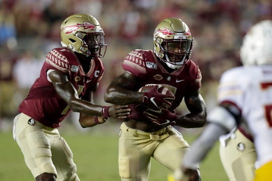 Florida State Seminoles quarterback James Blackman (1) hands off the ball to Florida State Seminoles running back Cam Akers (3) to run into the end zone. The Florida State Seminoles beat the Louisiana Monroe Warhawks 45-44 in overtime.