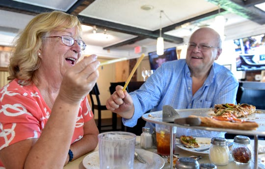 "Kathy and Jack Krantz, of Port St. Lucie, have a few moments of fun with their pasta straws after dinner at Pappa Louie's Italian Restaurant with friend Tony Ferrino (not pictured) on Sunday, August 25, 2019, in Port St. Lucie. ""I love it, I think it's innovative, I think it's green and it's a fun idea,"" Jack Krantz said. The restaurant has switched from plastic straws to pasta straws to help cut the volume of single-use plastic straws littering Florida beaches and waterways."