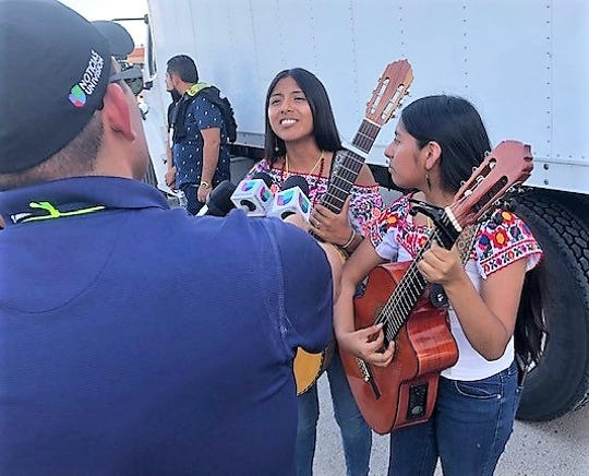 Emily and Sheyla Rosas, from San Diego,who perform as Dueto Dos Rosas, were interviewed by a TV reporter before perorming at the #ElPasoFirme Music Fest at Ascarate park Sept. 7.