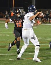 Sophomore linebacker Ralph Navarro pressures quarterback Adam Carr in Ventura College's eason opener against Orange Coast on Saturday night at the VC Sportsplex. Top-ranked VC won, 45-7.