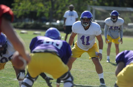 Ventura High graduate Connor McDermott, a linebacker for CLU, gets ready for a snap at practice.