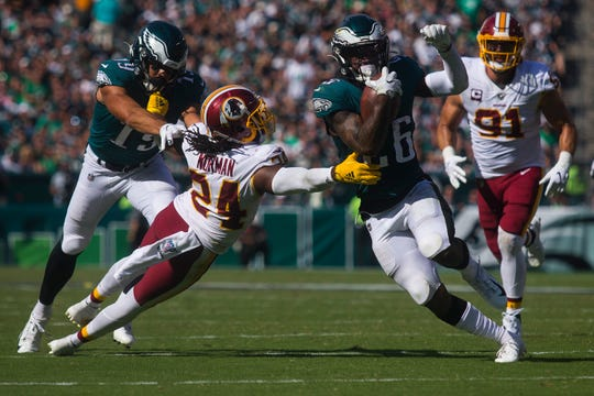 Eagles' Miles Sanders (26) runs out of the grasp of Washington's Josh Norman (24) Sunday, Sept. 22 at Lincoln Financial Field.