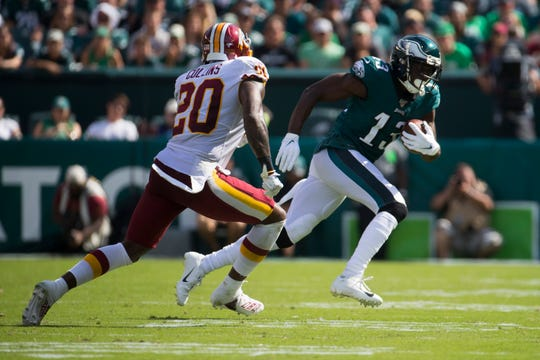 Eagles' Nelson Agholor runs away from Washington's Landon Collins (20) after making a reception Sunday at Lincoln Financial Field.