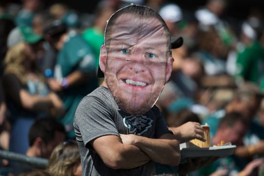 A fan wears a giant Carson Wentz mask Sunday at Lincoln Financial Field.