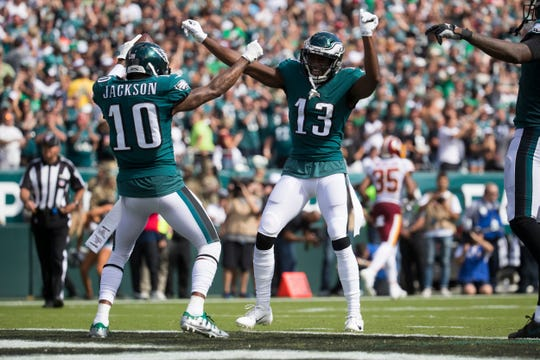 Eagles' DeSean Jackson (10) dances with Nelson Agholor (13) after Jackson scored his second touchdown of the game last Sunday at Lincoln Financial Field.