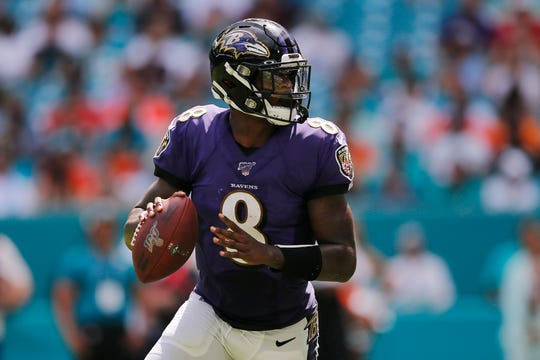 Lamar Jackson #8 of the Baltimore Ravens looks to pass against the Miami Dolphins during the third quarter at Hard Rock Stadium on September 8, in Miami.