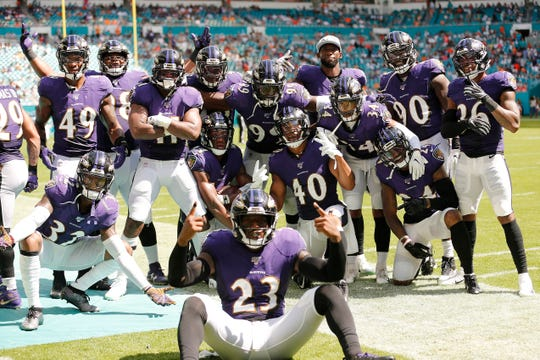 The Baltimore Ravens defense celebrates after a interception by Marlon Humphrey #44 against the Miami Dolphins during the fourth quarter at Hard Rock Stadium on September 08, 2019 in Miami.