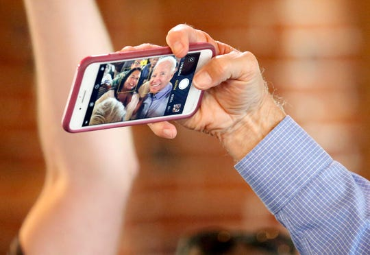 Democratic presidential candidate former Vice President Joe Biden takes a selfie with a potential supporter during a campaign stop, Friday, Sept. 6, 2019, in Laconia, N.H.