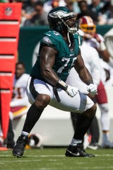 Eagles' Vinny Curry (75) celebrates a defensive stop Sunday against the Redskins at Lincoln Financial Field.