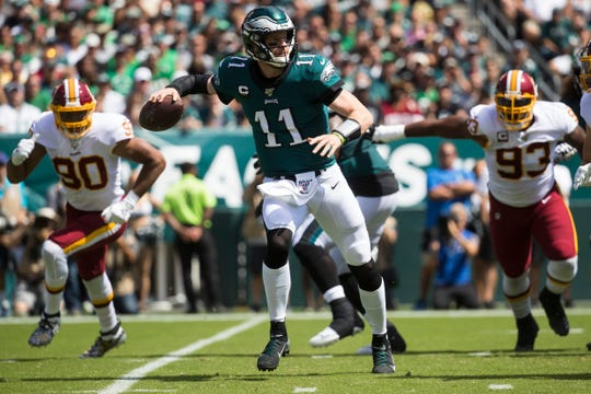 Eagles' Carson Wentz (11) looks to pass downfield Sunday against the Redskins at Lincoln Financial Field.