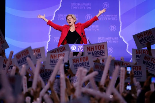 Democratic presidential candidate Sen. Elizabeth Warren, D-Mass., acknowledges the applause as she arrives on stage to speak at the New Hampshire state Democratic Party convention, Saturday, Sept. 7, 2019, in Manchester, NH.