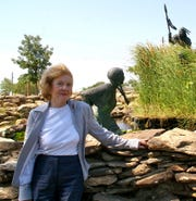 """Marybeth Little Weston stands in 2011 near Jack Stevens' Wee-Chi-tah sculpture, something she wanted to see on her visit to her hometown. Weston's book """"The Comanche with Blue Eyes"""" tells the story of Cynthia Ann Parker."""