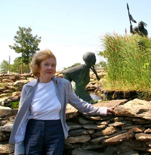 "Marybeth Little Weston stands in 2011 near Jack Stevens' Wee-Chi-tah sculpture, something she wanted to see on her visit to her hometown. Weston's book ""The Comanche with Blue Eyes"" tells the story of Cynthia Ann Parker."