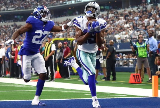 Dallas Cowboys receiver Amari Cooper catches a second quarter touchdown pass against New York Giants cornerback DeAndre Baker.