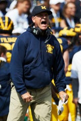 Michigan head coach Jim Harbaugh reacts to a call in the first half against Army.