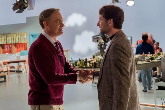"""Mr. Rogers (Tom Hanks, left) meets journalist Lloyd Vogel (Matthew Rhys) in """"A Beautiful Day in the Neighborhood."""""""