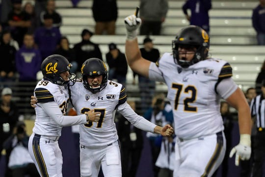 California kicker Greg Thomas, left, celebrates with holder Steven Coutts (37) and offensive lineman McKade Mettauer (72) after Thomas kicked the game-winning field goal late against Washington.