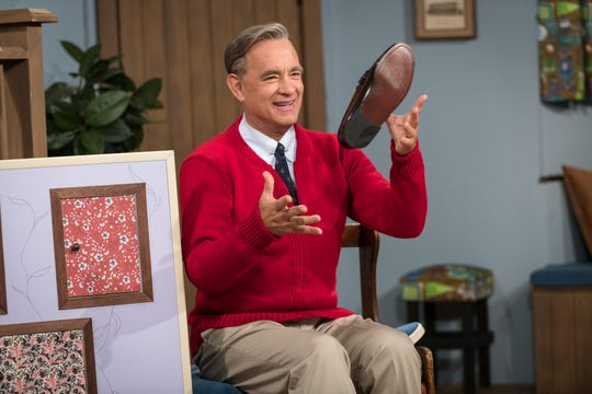 "Mr. Rogers (Tom Hanks) changes his shoes in trademark fashion in ""A Beautiful Day in the Neighborhood."""