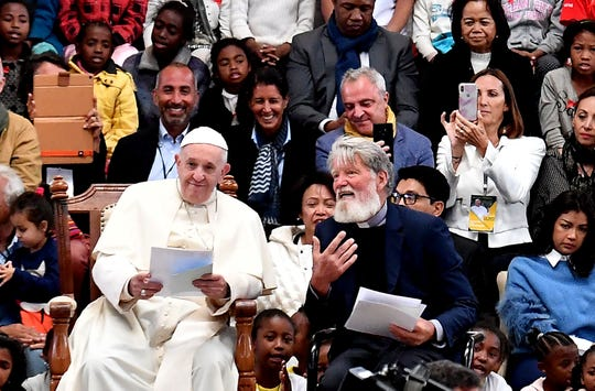Pope Francis' attends next to Father Pedro's Opeka during a meeting at the humanitarian association Akamasoa in Antananarivo, Madagascar, on September 8, 2019. - Pope Francis visit three-nation tour of Indian Ocean African countries hard hit by poverty, conflict and natural disaster.
