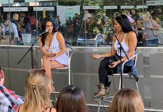 "Brie, left, and Nikki Bella during their ""Wine Down with The Bella Twins"" Q&A at Saturday's USA TODAY Wine and Food Experience in Brooklyn."