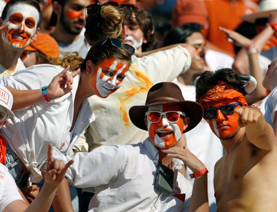 Texas Longhorns fans pose for a camera before the start of their game against LSU.
