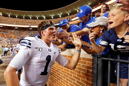 BYU quarterback Zach Wilson (1) celebrates an overtime win at Tennessee.
