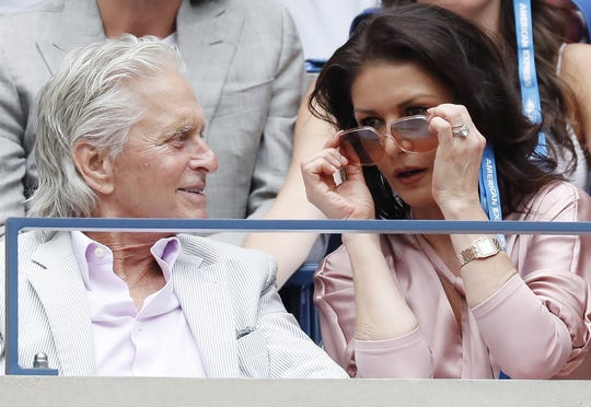 Sept. 8: Actor Michael Douglas and actress Catherine Zeta-Jones watch as Rafael Nadal plays Daniil Medvedev during the men's final.