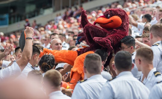 """""""The Hokie Bird"""" is lifted into the air by the Corp of Cadets during Virginia Tech's game against the Old Dominion Monarchs at Lane Stadium."""