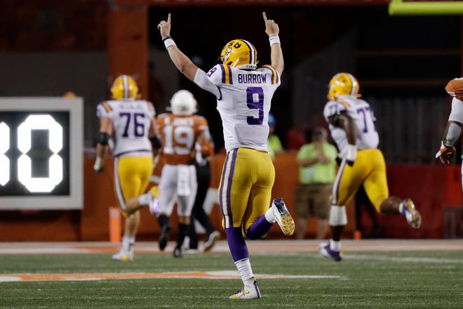 LSU quarterback Joe Burrow (9) celebrates after connecting with teammate wide receiver Justin Jefferson (2) for a touchdown against Texas.